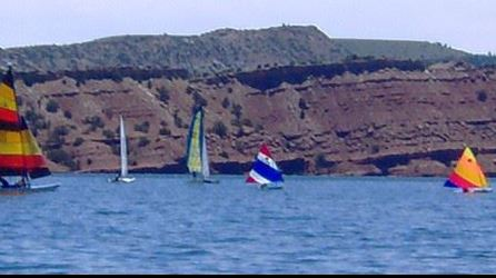 Sailboats on the water at Alcova Reservoir, cliffs in the background