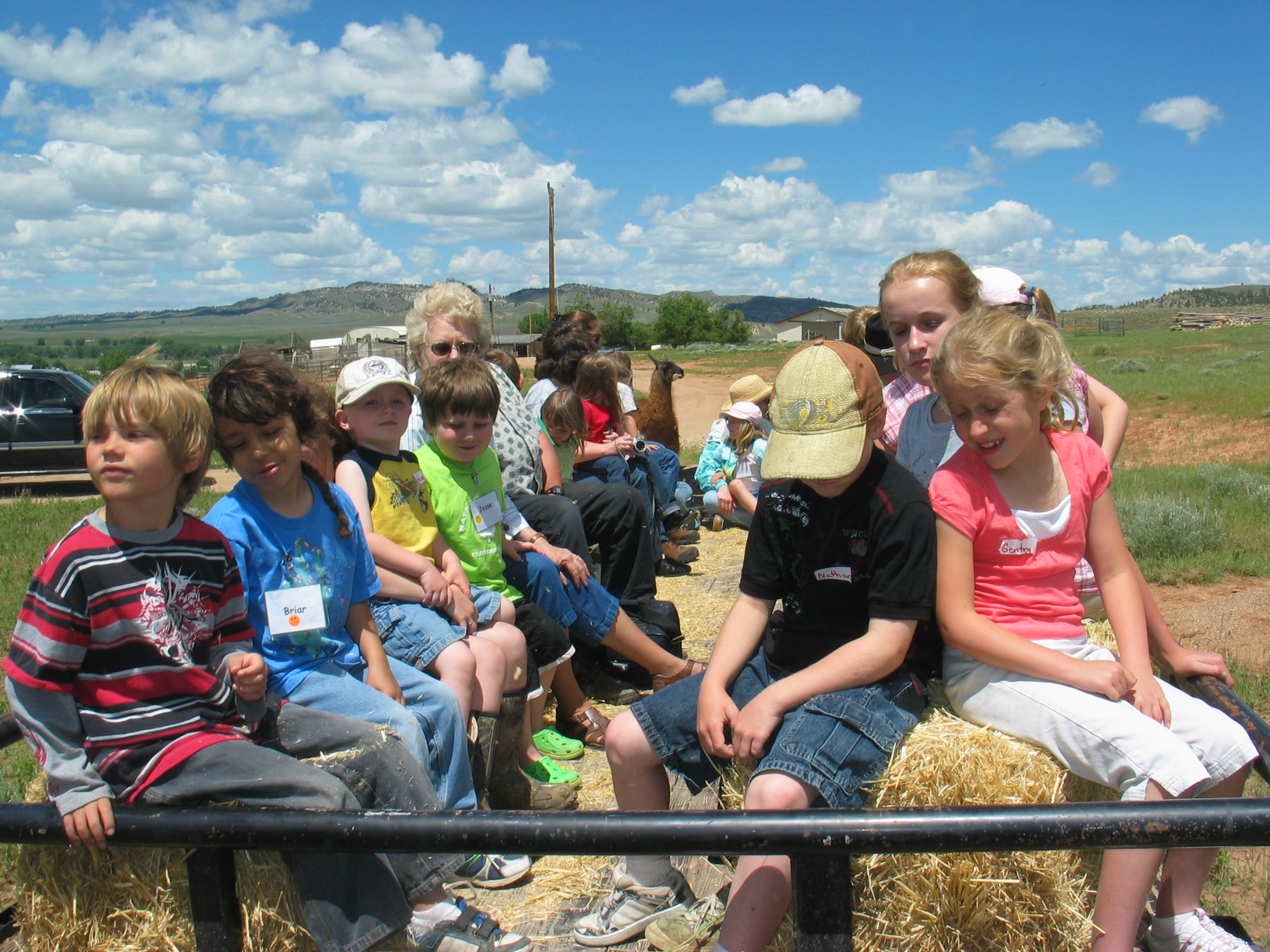 A group of children on hay bales.