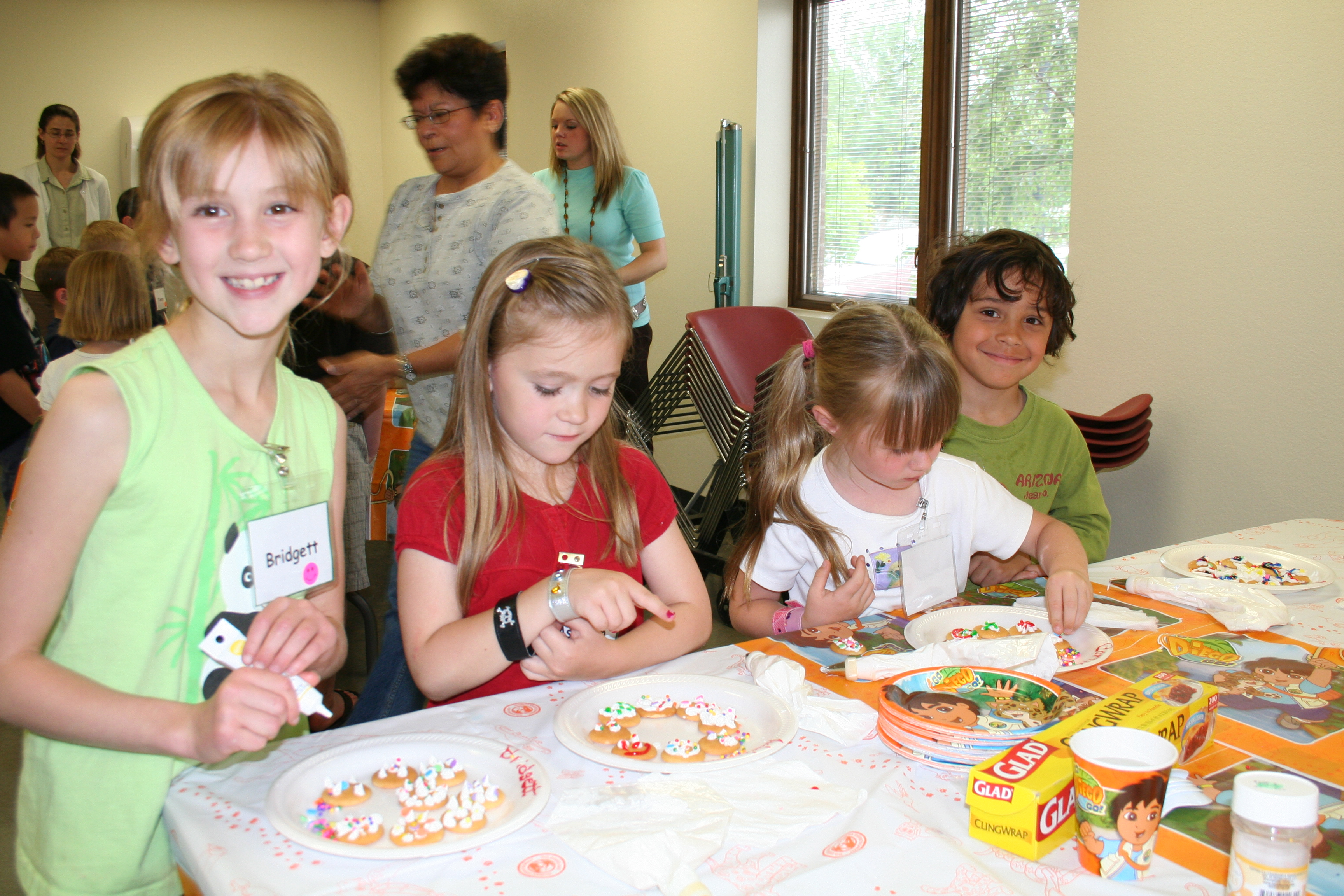 Children decorating cookies.